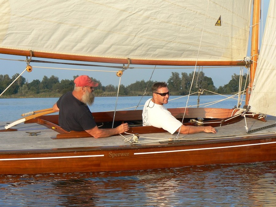 Rom and his dad sailing the dragon boat in Holland