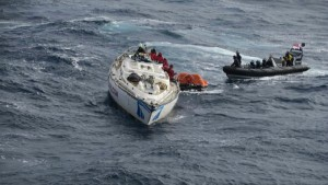 516542-racing-yacht-clyde-challenger-being-rescued-by-crew-of-hms-dragon