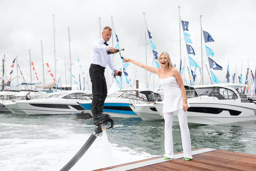Cheers Flyboarder James Prestwood ensured Georgia Toffolo'Toff' celebrated the opening of Southampton International Boat Show with fizz