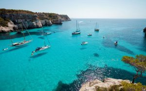 Menorca---getting-there---boats-in-macarella-xlarge